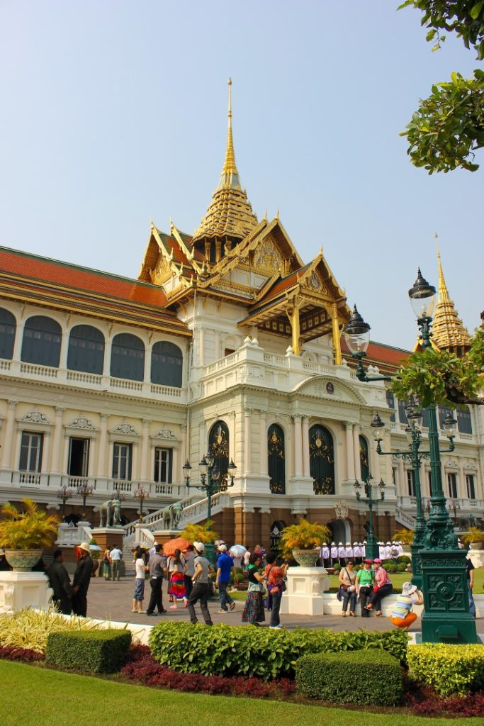 Crowds gather outside the Grand Palace.