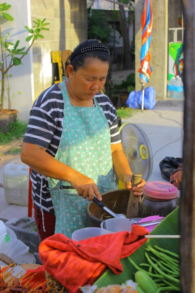 A lady making som tam bu at Fisherman's Village, Koh Samui.