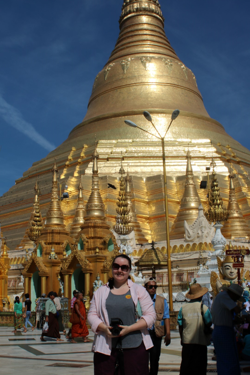 Standing in front of the glittering Shwedagon Pagoda. Yangon, Myanmar.